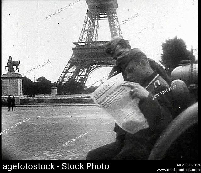 Two German Soldiers Reading A Newspaper Near the Eiffel Tower, Paris - Paris, Vichy France