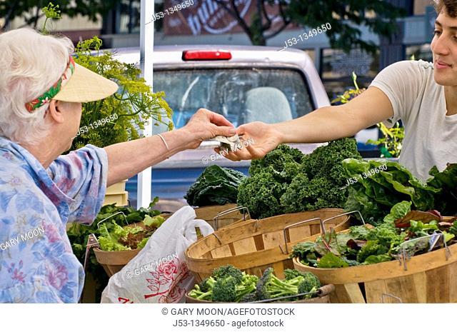 Buying organic produce at farmers' market, downtown Arcata, California