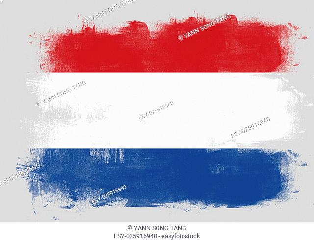 Flag of Netherlands painted with brush on solid background