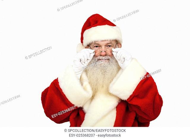 Santa Claus looking at something (real beard) isolated