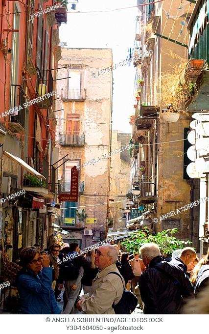 San Gregorio Armeno street with many people for shopping, photo taken in Naples, Campania, Italy
