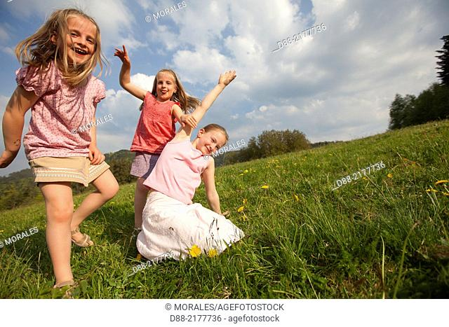 France, Bas Rhin, Urbeis near the Climont, girls in a meadow