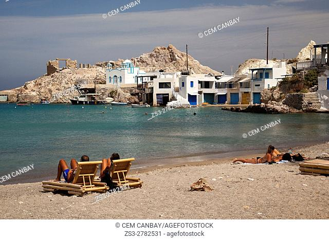 View to the Church in Firipotamos or Fyripotamos village with the people sunbathing in the foreground, Milos, Cyclades Islands, Greek Islands, Greece, Europe