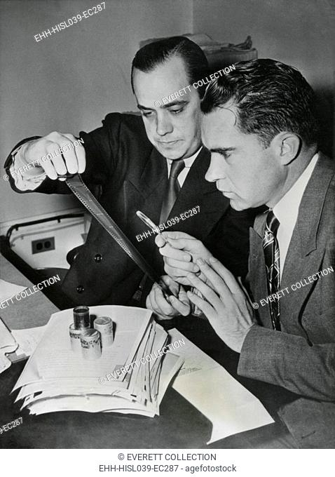 Richard Nixon examines the 'Pumpkin Paper' microfilms with Robert Stripling, HUAC Chief Investigator. The film contained 64 U.S