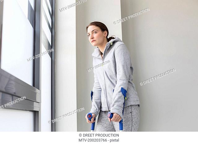 Patient with crutches looking sad