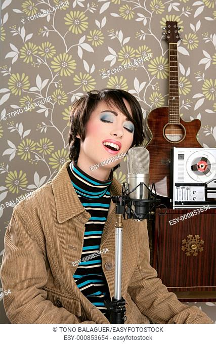 retro 60s singer woman microphone guitar reel tape in wallpaper recording studio