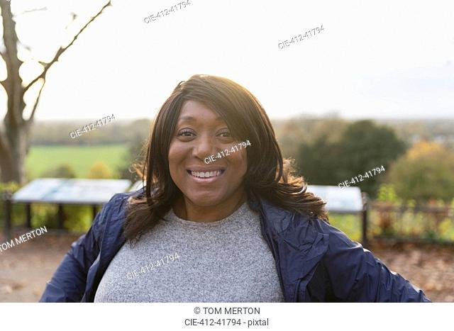 Portrait smiling, confident woman in park