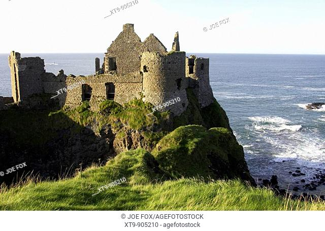 dunluce castle overlooking the atlantic ocean , county antrim, northern ireland