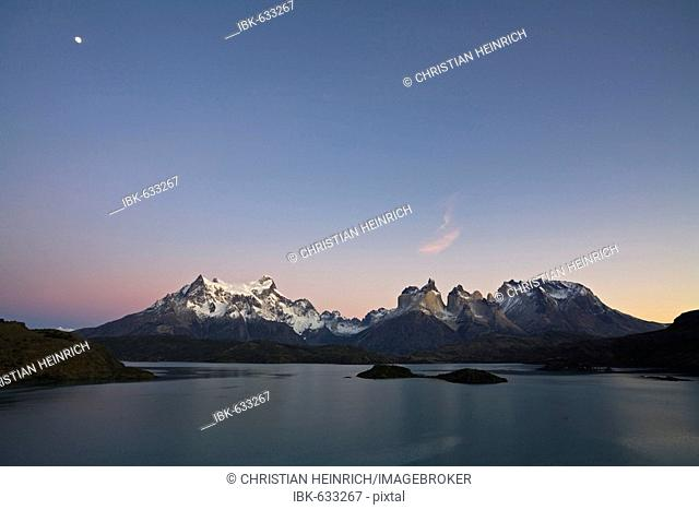 Dawn with moon at the Torres del Paine massif at the lake Lago Pehoe, national park Torres del Paine, Patagonia, Chlie, South America