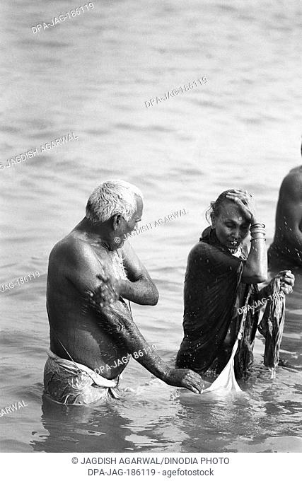 Couple bathing Makar Sankranti Hoogly river Kolkata West Bengal India Asia 1977