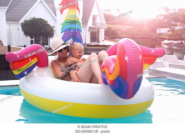 Mother and son in inflatable in pool, St Francis Bay, Eastern Cape, South Africa
