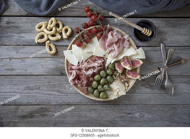 Italian antipasti platter with ham and cheese