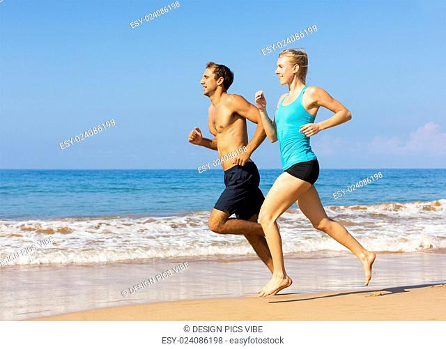 Couple running. Sport runners jogging on beach working out smiling happy. Fitness exercise concept
