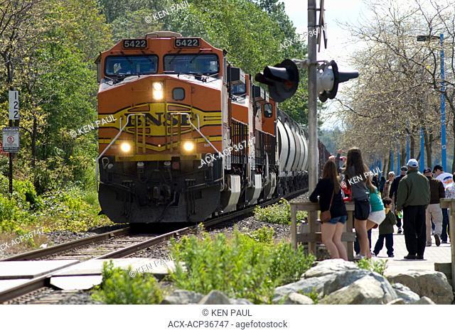 A BNSF mixed freight train travels through White Rock, BC, Canada