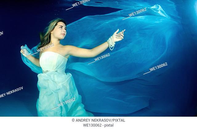 Woman presenting underwater fashion in pool, Odessa, Ukraine, Eastern Europe