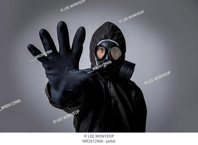 Portrait of man in black protective clothing holding a hand