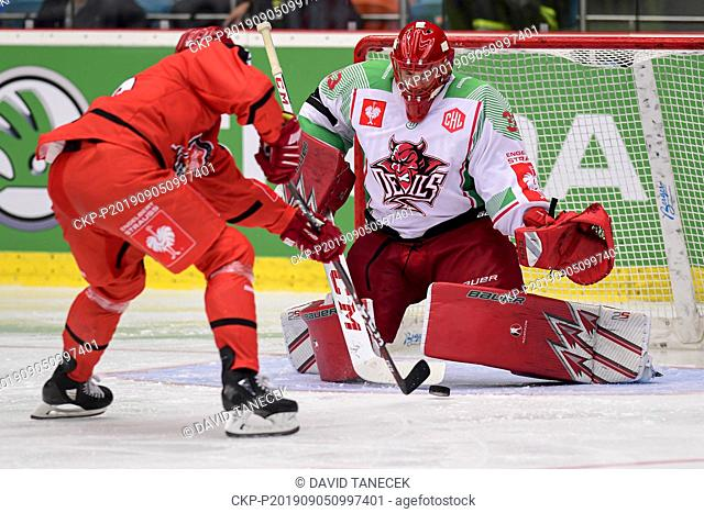 From left hockey player DANIEL RAKOS of Hradec Kralove scores and goalie of Cardiff BEN BOWNS receives a goal during the Champions Hockey League H group game:...