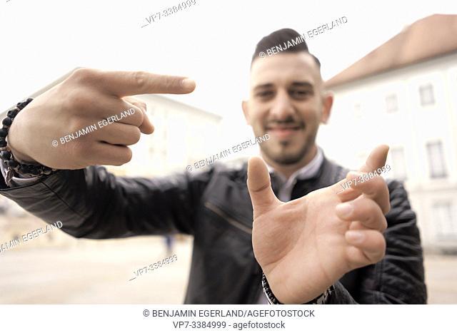 optimistic man framing hands