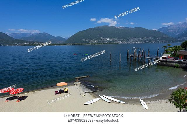 The ship dock at San Nazzaro with a view of the Swiss Alps- Lake Maggiore, Locarno, Ticino, Switzerland