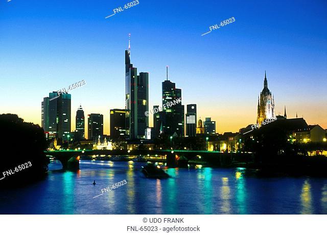 Silhouette of skyscrapers lit up at night, Main River, Frankfurt, Hessen, Germany