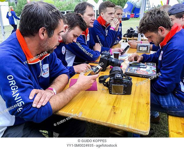 Hamburg, Germany. A whole bunch of photograhers asembled at a compound table just prior to the start of Roparun 2018 Event from Hamburg to Rotterdam
