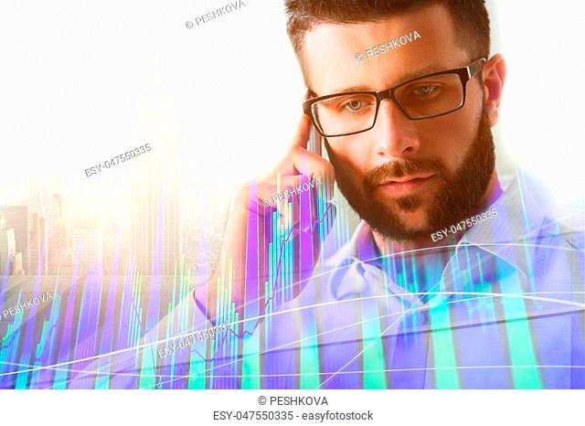 Portrait of attractive young european businessman using smartphone on abstract city background with forex chart. Technology, communication and stock concept