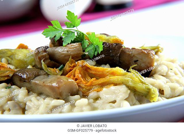 Rice with mushrooms and pumpkin flower
