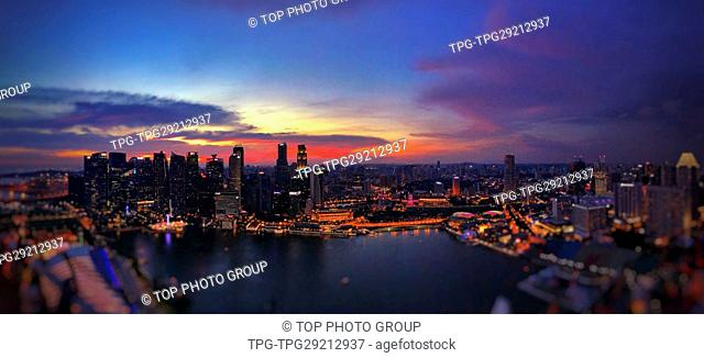 High angle view of the city at night through hotel Marina Bay Sands; Singapore