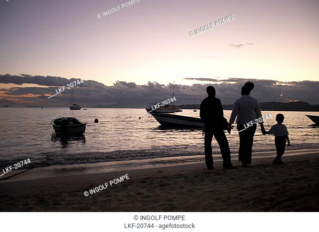 Family walking at the Sainte-Anne beach in the evening, Saint- Francois, Grande-Terre, Guadeloupe