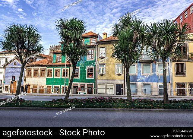 Town houses on Rua de Dom Manuel II street in Porto city, second largest city in Portugal. Senhor da Boa Nova Chapel on left side