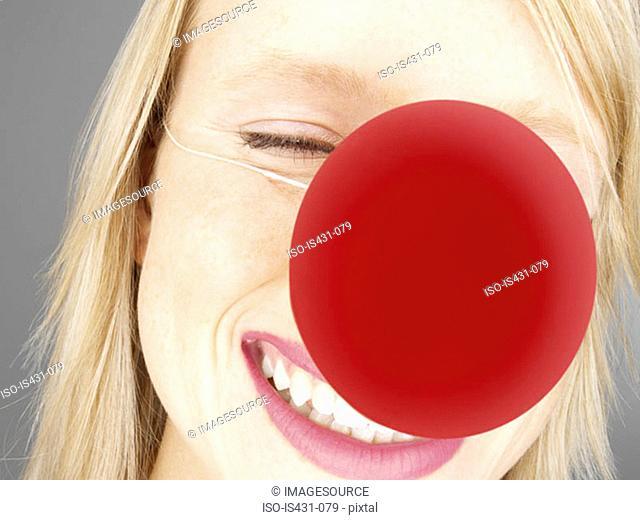 Woman wearing a clowns nose