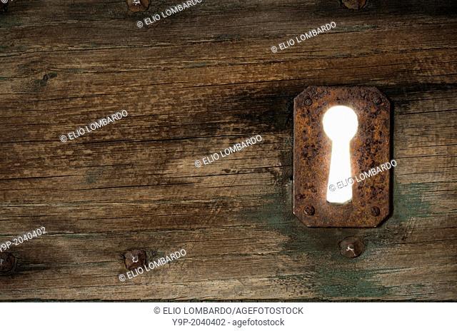Detail of an Old Door with Rusty Keyhole. Civita di Bagnoregio, Viterbo District, Lazio, Italy