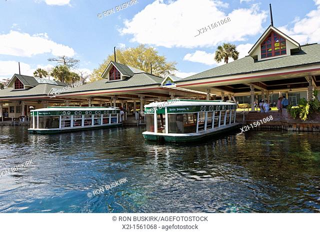 Park guests take glass bottom boat tour of the Silver River at Silver Springs Attractions in Ocala Florida
