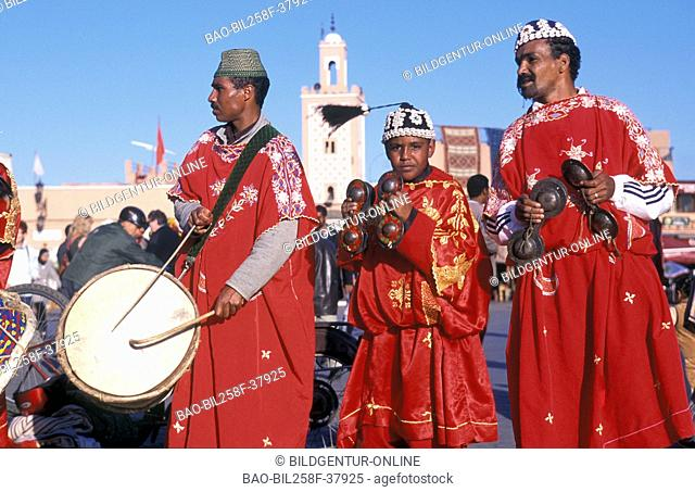 Traditional musicians and bateleur eagles on the Djemma el Fna place in the Old Town of Marrakesh in Morocco in North Africa