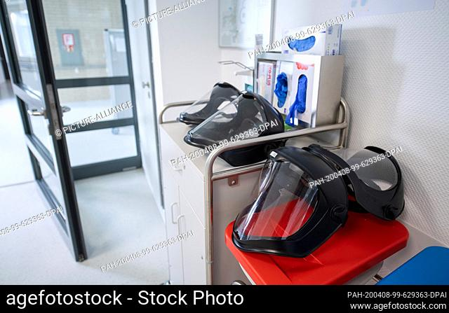 06 April 2020, Baden-Wuerttemberg, Künzelsau: Face masks for full protection are located in an isolation ward in a former clinic