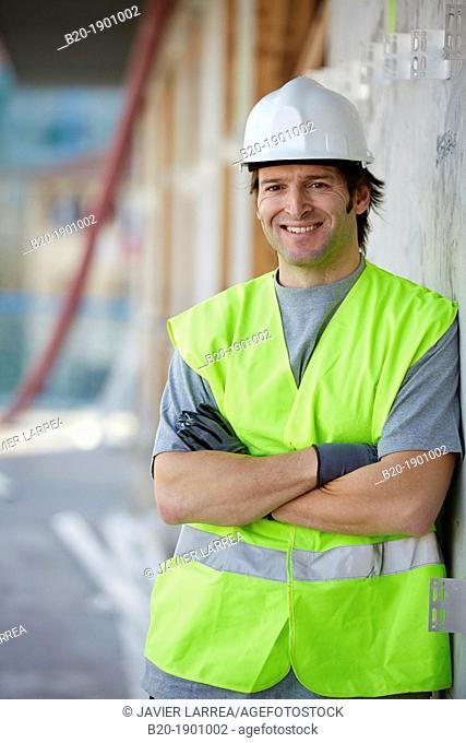 Mason, Bricklayer with personal protective equipment, PPE, Apartment Building under construction, Donostia, San Sebastian, Gipuzkoa, Basque Country, Spain