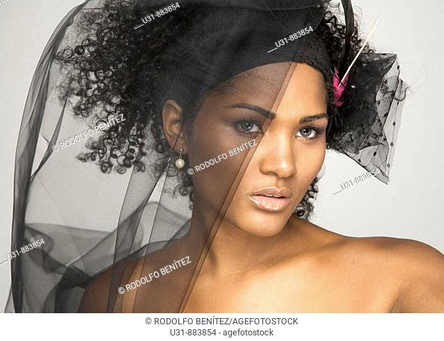 Black Latin girl with sexy wavy hair and black veil