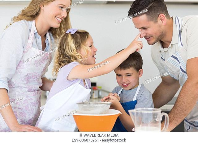 Parents and children baking cookies