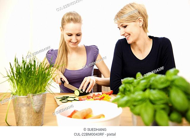 Young Women Preparing Food, eating