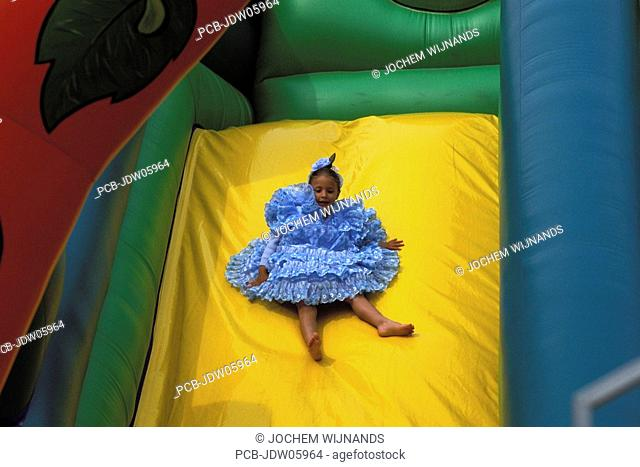 Feria of Jerez de la Frontera, girl sliding down
