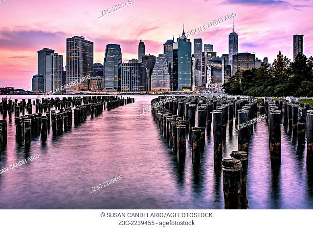 Great view of the New York City lower Manhattan Skyline during a dramatic sunset. One World Trade Center (WTC) commonly referred to as the Freedom Tower along...