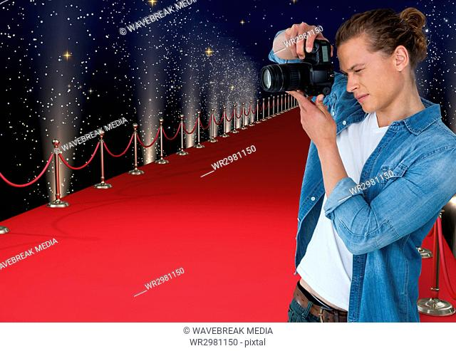3d photographer taking a photo in the red carpet. Lights and stars back