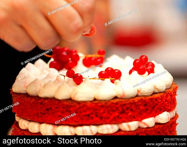 Red velvet cake preparation. It is composed of buttermilk or vinegar component that activated with the baking soda to make it super fluffy or velvety