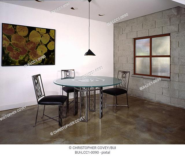 Dining table and chairs in industrial interior