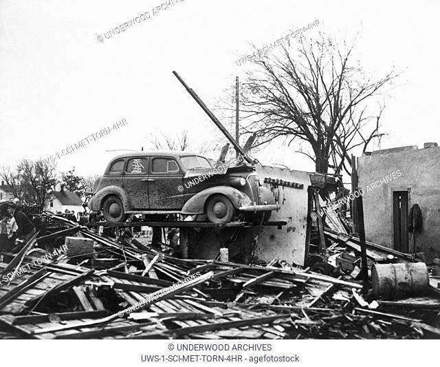 Iowa: 1948 The remnants of an auto repair shop after a tornado came through the town