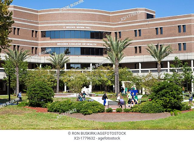 Students walk past the Brooks College of Health building at the University of North Florida in Jacksonville, Florida
