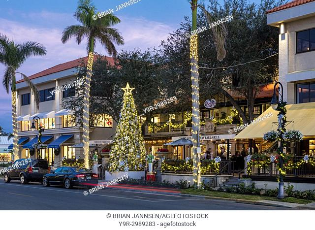 Christmas tree and decorations in courtyard shopping and restaurant near 3rd Street, Naples, Florida, USA