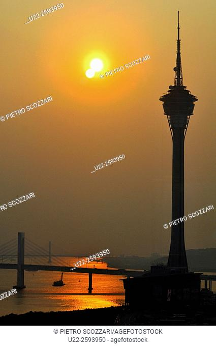 Asia, China, Macao, the Macao Tower by the Pearl River at sunset...