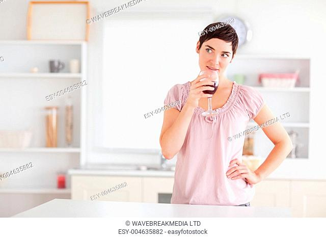 Thoughtful woman drinking wine