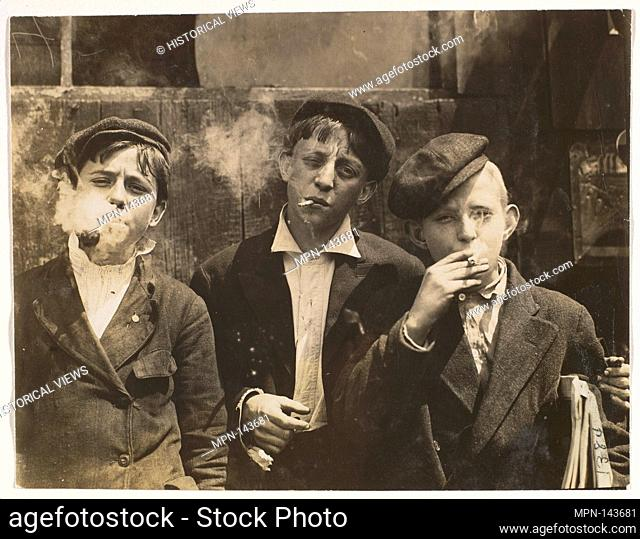 11:00 A.M. Monday, May 9th, 1910. Newsies at Skeeter's Branch, Jefferson near Franklin. They were all smoking. Location: St. Louis, Missouri